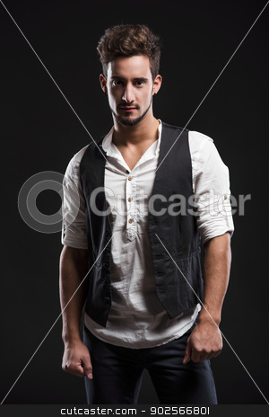 Fashion young man stock photo, Studio portrait of a handsome and fashion young man, posing over a dark background by ikostudio