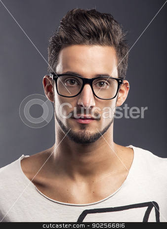 Handsome young man stock photo, Casual portrait of a hansome young man wearing glasses, looking to the camera by ikostudio