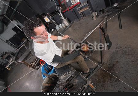 Artisan Handling Hot Glass stock photo, Handsome glass artisan handling glowing hot object by Scott Griessel