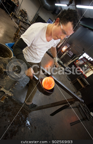 Man Working with Hot Glass stock photo, Small business glass manufacturer forming glowing hot object by Scott Griessel