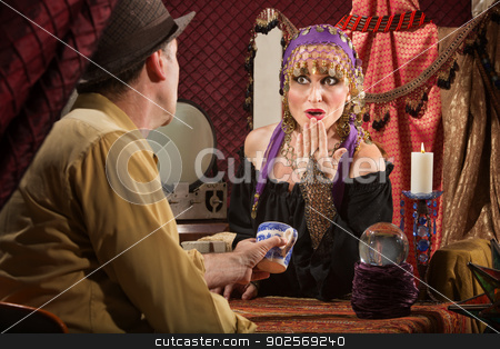 Gypsy Reading Tea Leaves stock photo, Beautifiul Gypsy woman reading tea leaves for customer by Scott Griessel