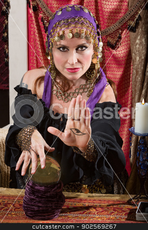 Lady with Evil Eye Curse stock photo, Mysterious female fortune teller showing an evil eye in palm by Scott Griessel
