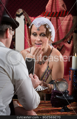 Interested Fortune Teller stock photo, Fascinated Caucasian fortune teller with businessman customer by Scott Griessel