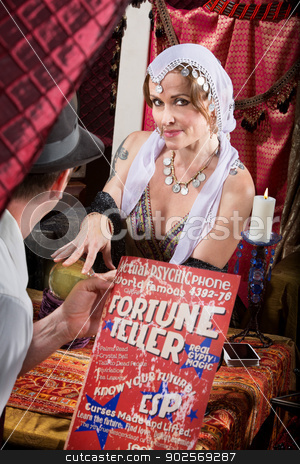 Customer with Fortune Teller stock photo, Customer with poster visiting beautiful gypsy fotune teller by Scott Griessel