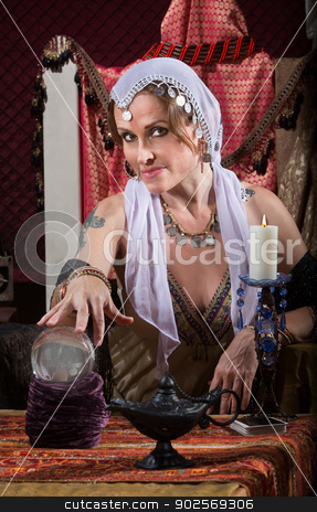 Exotic Woman with Crystal Ball stock photo, Exotic Romani woman with candle and crystal ball by Scott Griessel
