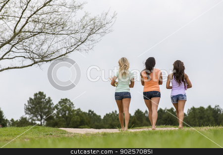3 Girls Enjoying The Park stock photo, Three young women enjoying a day at the park by Walter Arce