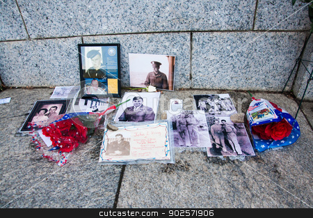 WASHINGTON, D.C. - MAY 27, 2013: People visit and lay flowers at the World War II Memorial on May 27, 2013, in Washington, D.C.  stock photo,  by Hang Dinh