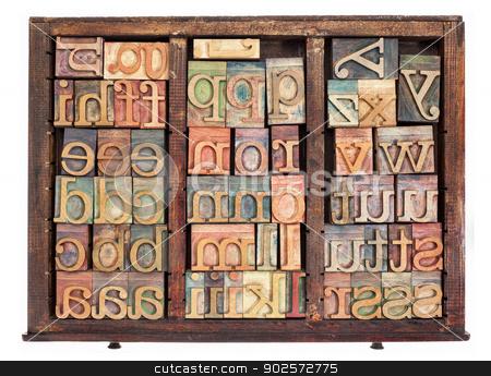 letterpress wood type stock photo, alphabet - letterpress wood type printing blocks in old typesetter drawer isolated on white by Marek Uliasz