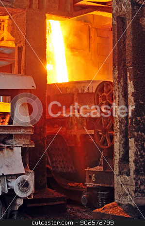 Pouring of liquid metal stock photo, Molten hot steel pouring in plant by Iordache Magdalena