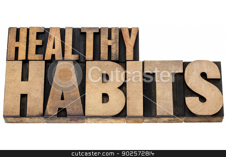 healthy habits in wood type stock photo, healthy habits - wellness concept - isolated tex in vintage letterpress wood type by Marek Uliasz