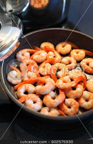 Frying shrimp stock photo, Photo of shrimp being fried in butter on a black frying pan. Shallow depth of field with focus across the middle. by © Ron Sumners