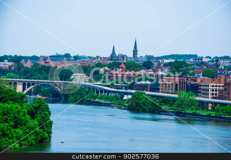 elevated view of Washington DC by the Potomac river. In the picture are Key bridge, and Georgetown waterfront park and harbor. stock photo,  by Hang Dinh