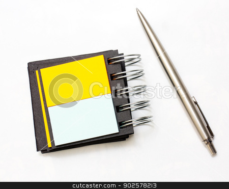 Pen beside note stock photo, A pen pying beside a coloured notebook by Tommy Alsén