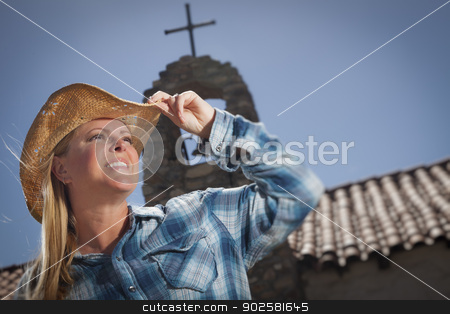 Beautiful Cowgirl Portrait with Old Church Behind stock photo, Beautiful Cowgirl Portrait with Old Church and Cross Behind. by Andy Dean