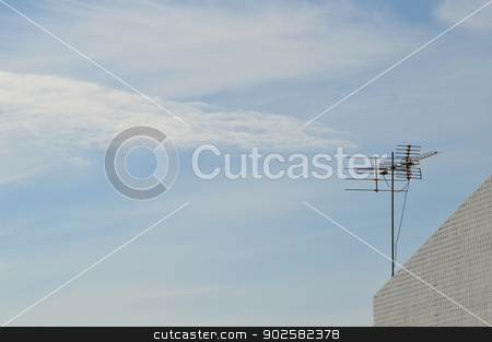 TV antenna on the roof top stock photo, TV antenna on the roof top with blue sky by Lekchangply
