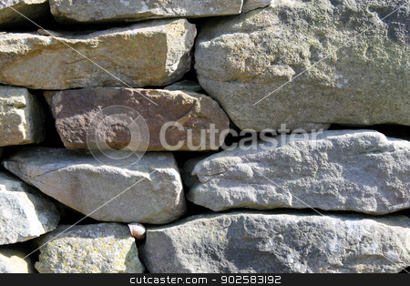 Dry stone wall background stock photo, Abstract background of dry stone wall in countryside. by Martin Crowdy