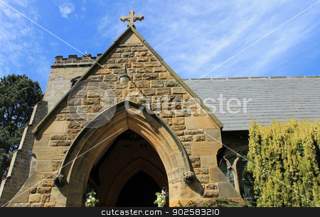 Exterior of old stone church stock photo, Exterior of old stone church in Scalby village, England. by Martin Crowdy