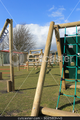 School playground stock photo, School climbing frame with playground and sports hall in background, Scarborough, England. by Martin Crowdy