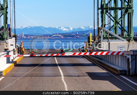 Bainbridge Island Ferry Dock Gate Puget Sound Seattle Cascade Mo stock photo, Bainbridge Island Ferry Dock Gate Puget Sound Seattle Cascade Mountains in Distance Kitsap County Washington State Pacific Northwest  by William Perry
