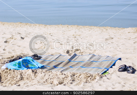 Sandy beach stock photo, Summer carpet with bag, and flip flops on sandy beach by Lacroix