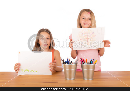Young girls show their drawings stock photo, Two sisters with blond hair smiling and showing their super drawings at a wooden table with metallic pencils holder. Isolated on white background. by doupix
