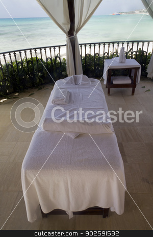 Beach Massage Table stock photo, A single massage table by the beach by Kevin Tietz