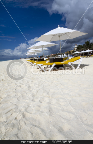 Beach Lounge with Umbrellas stock photo, Rows of several lounge chairs and umbrellas on the beach by Kevin Tietz