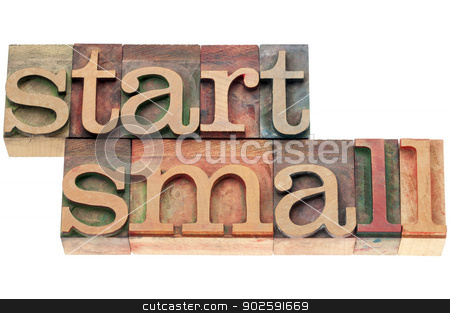 start small in wood type stock photo, start small advice  - isolated text in letterpress wood type by Marek Uliasz