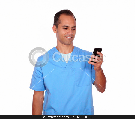 Smiling young nurse sending message on cellphone stock photo, Portrait of a smiling young nurse sending message on cellphone on isolated background by pablocalvog