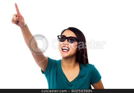 Jolly female model pointing at something stock photo, Young smiling asian model looking up and pointing towards something by Ishay Botbol
