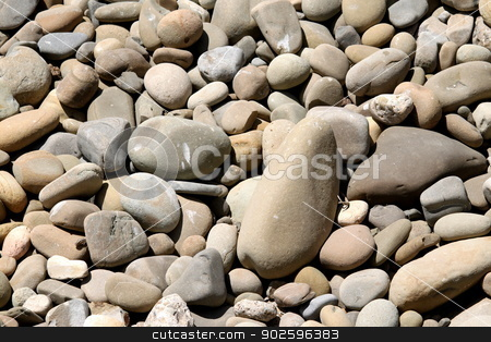 River Rocks Pebbles stock photo, River rock pebbles with shades of different gray. by Henrik Lehnerer