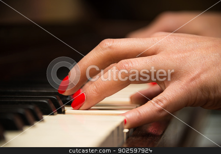 Female pianist hands stock photo, Female pianist hands closeup and piano keyboard by Dutourdumonde
