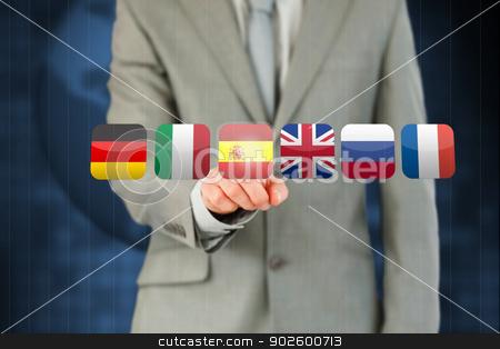 Businessmans finger activating state flags on touchscreen stock photo, Businessmans finger activating state flags touchscreen against a blue background by Wavebreak Media