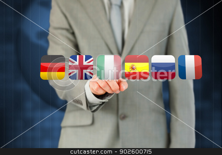 Businessmans finger activating futuristic touchscreen with vario stock photo, Businessmans finger activating futuristic touchscreen with various flags against a blue background by Wavebreak Media