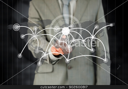 Businessman activating futuristic touchscreen stock photo, Businessman activating futuristic touchscreen against a black background by Wavebreak Media