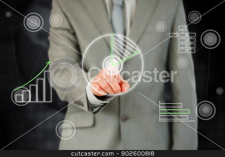 Businessman activating touchscreen against a black background stock photo, Businessman activating futuristic touchscreen against a black background by Wavebreak Media