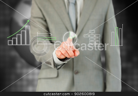 Businessman working with touch screen stock photo, Businessman working with touch screen against a black background by Wavebreak Media