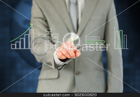 Businessmans finger working with touchscreen stock photo, Businessmans finger working with touchscreen against a background by Wavebreak Media