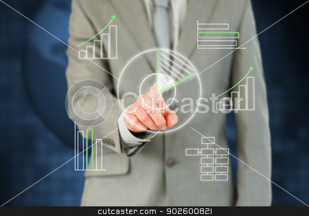 Man in suit working with touch screen stock photo, Man in suit working with touch screen against a background by Wavebreak Media