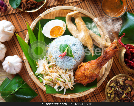 Nasi kerabu  stock photo, Nasi kerabu is a type of nasi ulam, popular Malay rice dish. Blue color of rice resulting from the petals of  butterfly-pea flowers. Traditional Malaysian food, Asian cuisine. by szefei