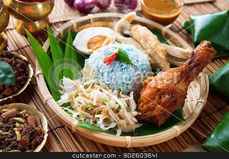 Nasi kerabu or nasi ulam stock photo, Nasi kerabu or nasi ulam, popular Malay rice dish. Blue color of rice resulting from the petals of  butterfly-pea flowers. Traditional Malaysian food, Asian cuisine. by szefei