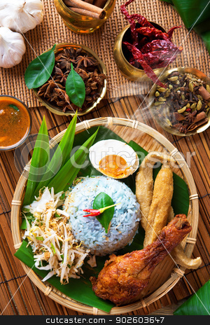 Malay food nasi kerabu stock photo, Traditional Malaysian food, Asian cuisine. Nasi kerabu is a type of nasi ulam, popular Malay rice dish. Blue color of rice resulting from the petals of  butterfly-pea flowers by szefei