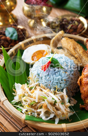 Malay rice dish nasi kerabu stock photo, Nasi kerabu is a type of nasi ulam, popular delicious Malay rice dish. Blue color of rice resulting from the petals of  butterfly-pea flowers. Traditional Malaysian food, Asian cuisine. by szefei