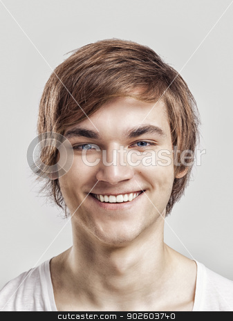 Happy face stock photo, Portrait of a handsome young man, over a gray background by ikostudio