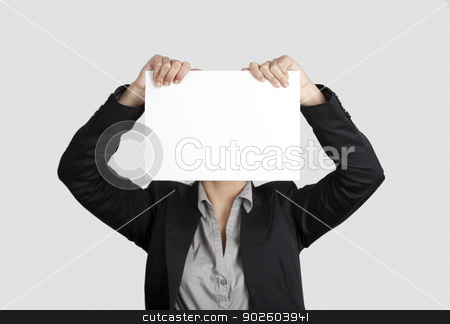 Paper face stock photo, Woman showing a blank paper sheet in front of her head  by ikostudio