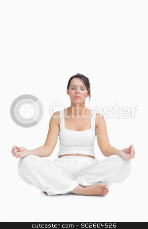 Young woman sitting in lotus position stock photo, Young woman sitting in lotus position over white background by Wavebreak Media