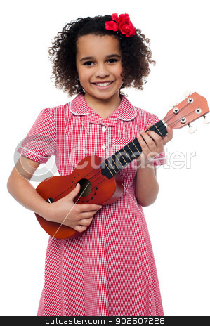 A little girl with a toy guitar stock photo, Pretty girl kid loves music. Holding toy guitar in hand by Ishay Botbol