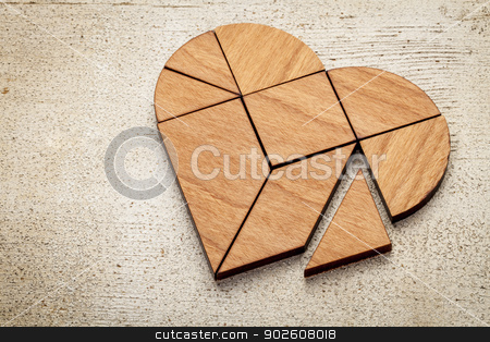 heart tangram stock photo, heart version of tangram, a traditional Chinese Puzzle Game made of different wood parts to build abstract figures from them, on white painted barn wood by Marek Uliasz