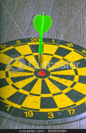 Target stock photo, A green dart hitting the center of a target by Fabio Alcini