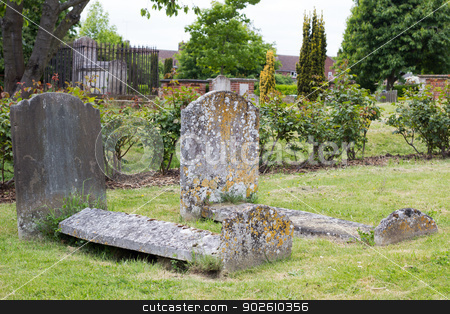 Old weathered tombs in graveyard stock photo, Two old and weathered stone coffins  in a churchyard in England. by Brigida Soriano